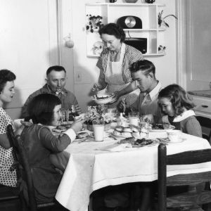 Mrs. Calbert Johnson of Four Oaks and family eating a meal