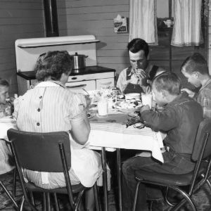 Mrs. Eugene Puckett of Clayton and family eating a meal