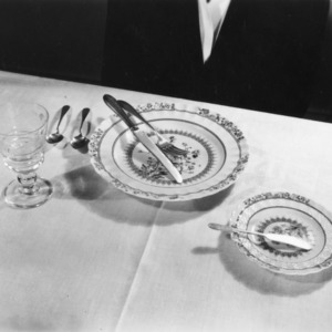 Table setting on a white table cloth