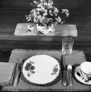 Place setting on a table with a placemat and a center piece