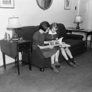 Two girls participating in a reading unit of a house furnishings project in Guilford County in May of 1939