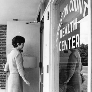 Home economics extension worker entering Johnston County Health Center, June 12, 1967
