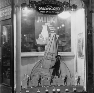Drugstore window display advertising the benefits of milk