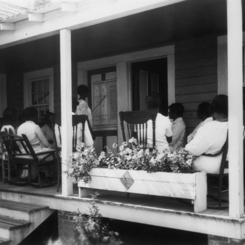 Group of women sitting on a porch for a demonstration