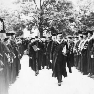Dean Edward L. Cloyd leading academic procession for 50th anniversary celebration