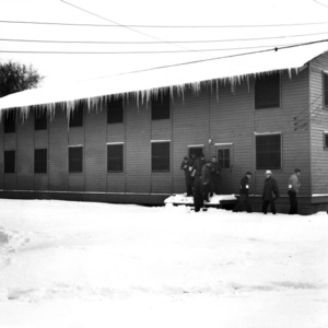 View of students leaving temporary classroom building, February 1948.