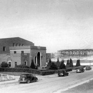 Thompson Gymnasium, with Reynolds Coliseum under construction in the background