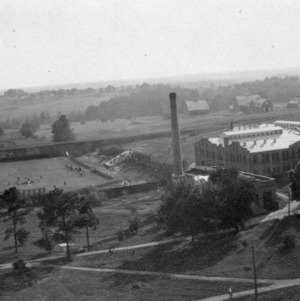 Bird's-eye view of North Carolina College of Agriculture and Mechanic Arts campus showing power plant and smokestack