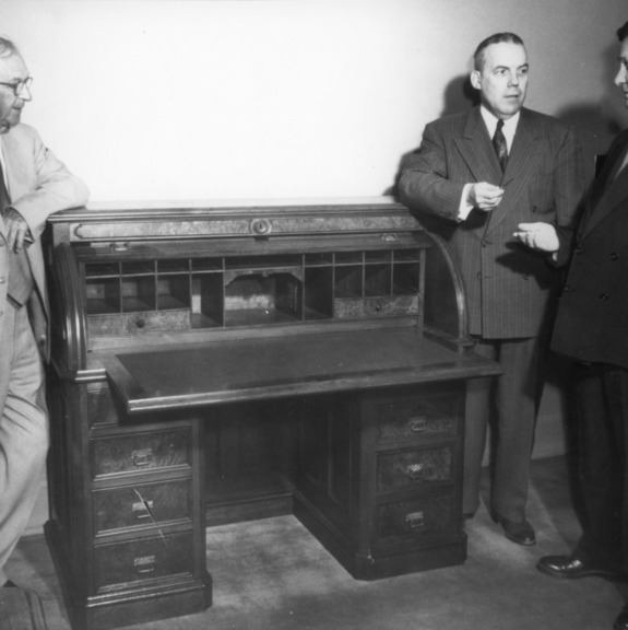 Ira O. Schaub, Chancellor J. W. Harrelson, and other with desk which the bill establishing North Carolina State College was drawn