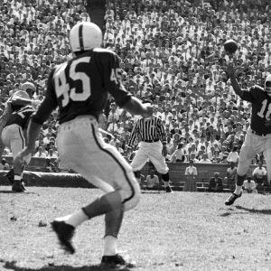 North Carolina State College quarterback Roman Gabriel passing to halfback John Stanton.
