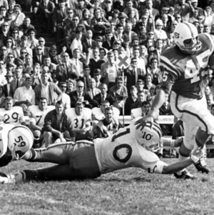 North Carolina State University wingback Gary Rowe breaking tackle in 21-0 win against Duke University, November 6, 1965.