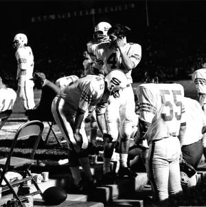 View of players on sidelines during North Carolina State University football game.