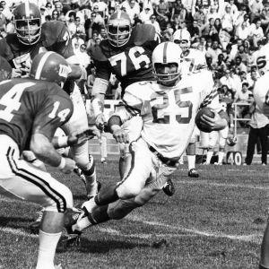 North Carolina State University halfback Leon Mason carrying football in game against University of Maryland.