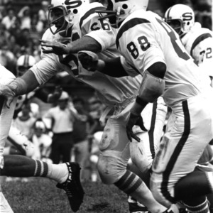 North Carolina State University defensive linemen Clyde Chesney (88) and George Smith (66)
