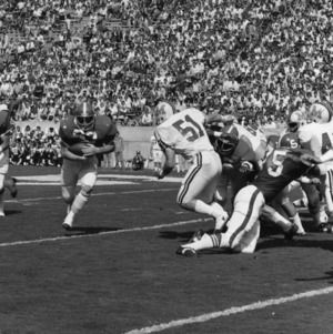 North Carolina State University quarterback Johnny Evans handing off to fullback Scott Wade in game against University of Maryland.