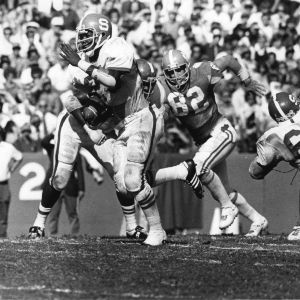 North Carolina State University fullback Ted Brown carrying football in game against Clemson, October 25, 1975.