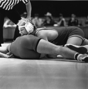 North Carolina State University wrestler Mike Koob attempting a cradle hold on University of Georgia wrestler Joe Birmingham, December 10, 1978.