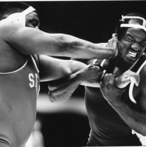 Tab Thacker, 1984 NCAA heavyweight champion from North Carolina State University, versus Stacey L. Davis of UNC-Chapel Hill