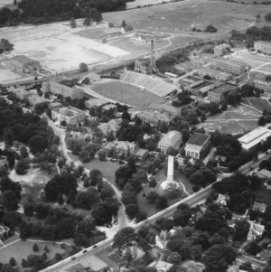 Aerial view of North Carolina State College, looking southwest toward Memorial Tower and Riddick Stadium
