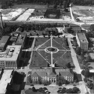 Aerial view of Patterson Hall, diesel engineering fountain, and Reynolds Coliseum construction