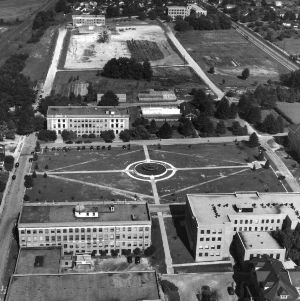 Aerial view of of North Carolina State College campus, looking west toward quadrangle and diesel engineering fountain