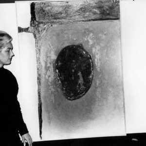 Painting being observed in gallery