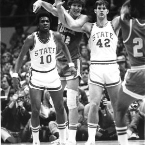 Moe Rivers (10) and Tim Stoddard (42) guarding Bill Walton during North Carolina State University's 80-77 win over UCLA in a 1974 NCAA basketball tournament semi-final game at Greensboro, N.C., March 23.
