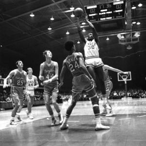 North Carolina State University basketball player Ed Leftwich attempting shot in game against Maryland.
