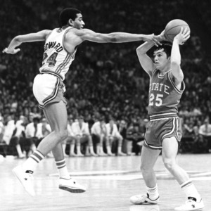 North Carolina State University basketball player Monte Towe looking to pass ball.