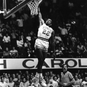 "NC State University basketball player Anthony ""Spud"" Webb dunking in game against Hofstra at Reynolds Coliseum"