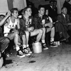Players are pictured taking a dipper of water in Memorial Auditorium.