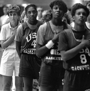 Coach Kay Yow and the United States Olympic team show pride during the playing of the National Anthem before an exhibition game in Raleigh