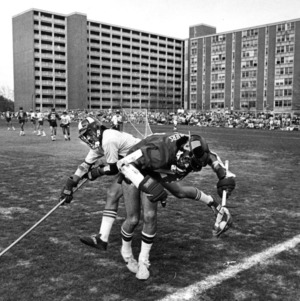 North Carolina State University's Ed Gambitsky checks a Virginia Cavalier in 1979 action at N.C. State.