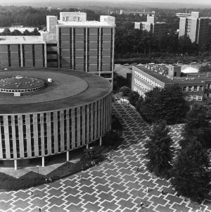 An aerial view of North Carolina State University's mid-campus features the architecturally unique, circular Harrelson Hall, a classroom building and campus landmark.
