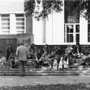Class meeting outside main entrance to D. H. Hill Library.