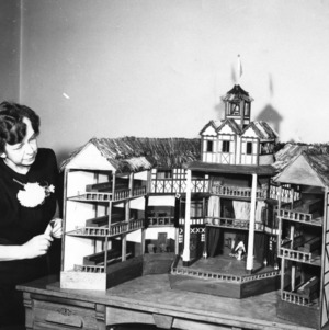 Librarian Katherine A. Edsall with display model of Globe Theater she created