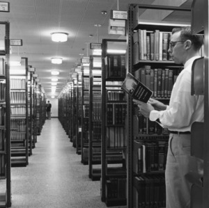 Student in the bookstacks, D. H. Hill Jr. Library