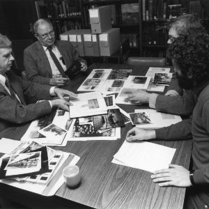 From left, Murray Downs, Burton Beers, Jim Rasor, and Jimmy Williams review photographs in the NCSU University Archives