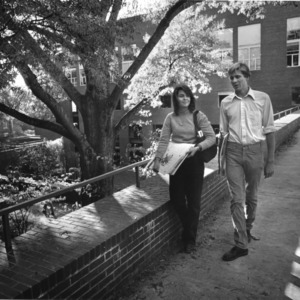 Ann Patterson and John Baker, students in the School of Design, walking above courtyard behind school.