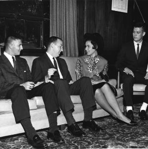 Miss Wool of America, Cheri Slikker, sitting with North Carolina State College School of Textiles students (left to right) Ernie York, John Bynum, and Bill Burgess