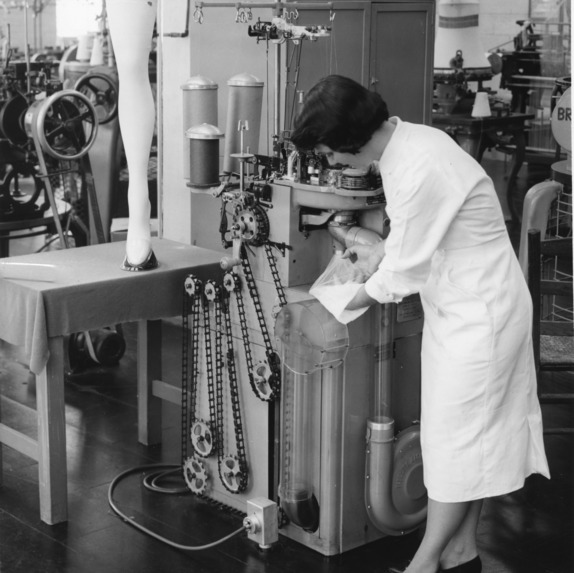 A view in the nylon hosiery knitting section showing a Fidelity 400 knitting machine. This machine was donated to the School of Textiles in 1958.