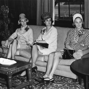 Three National Maid of Cotton contestants seated on sofa.