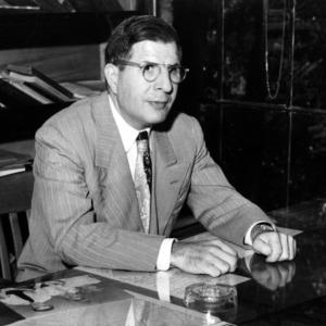 Dr. John W. Cell at desk