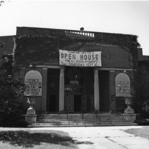 "Front view of Thompson Theater, North Carolina State University, showing ""Open House"" banner hanging above entrance."