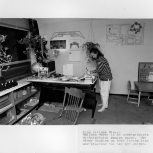 E. S. King Village, woman working in her apartment