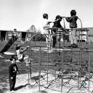 E. S. King Village, children playing on playground