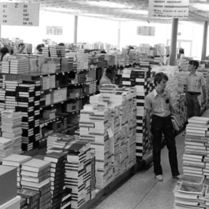 Students shopping for books at the Student Supply Store