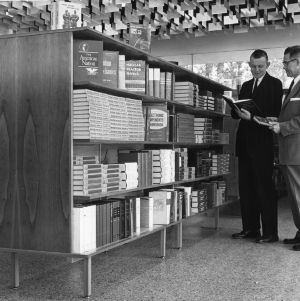 Cyrus B. King and Clement L. Chambers examining textbooks in newly constructed Student Supply Store