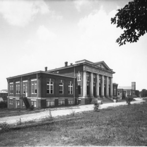 View of YMCA Building with Riddick Stadium and Thompson Hall in background, North Carolina State College