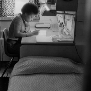 Metcalf Residence Hall, student studying in dorm room